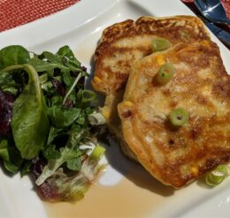 Corn and bacon pancakes with a side green salad